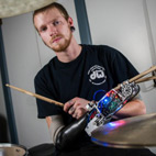 Robotic Prosthesis Helps Armless Drummer Return to Playing